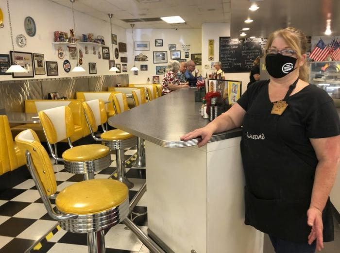 Restaurant manager Lori Pack stands at the counter of Linda's Soda Bar and Grill in Yuba City, Calif., Thursday, July 9, 2020