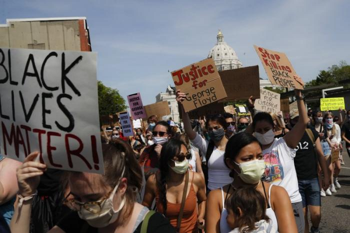 In this May 31, 2020, file photo, protesters march away from the State Capitol in St. Paul, Minn.