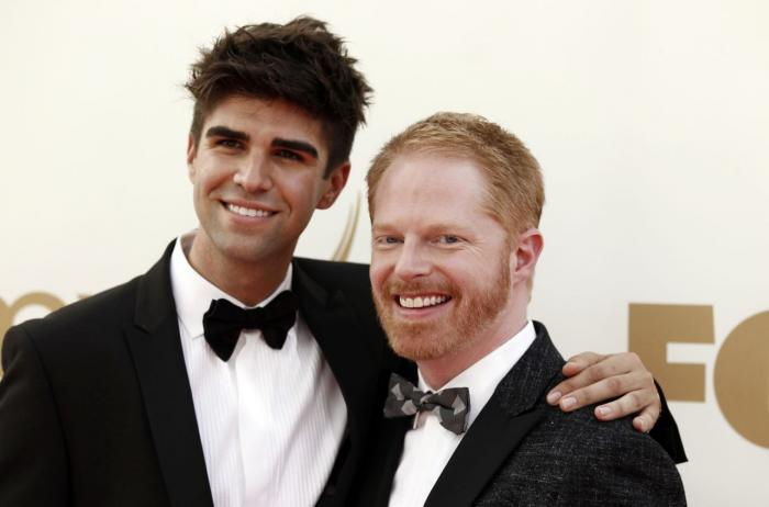 Justin Mikita and Jesse Tyler Ferguson at the 63rd Primetime Emmy Awards in 2011 in Los Angeles