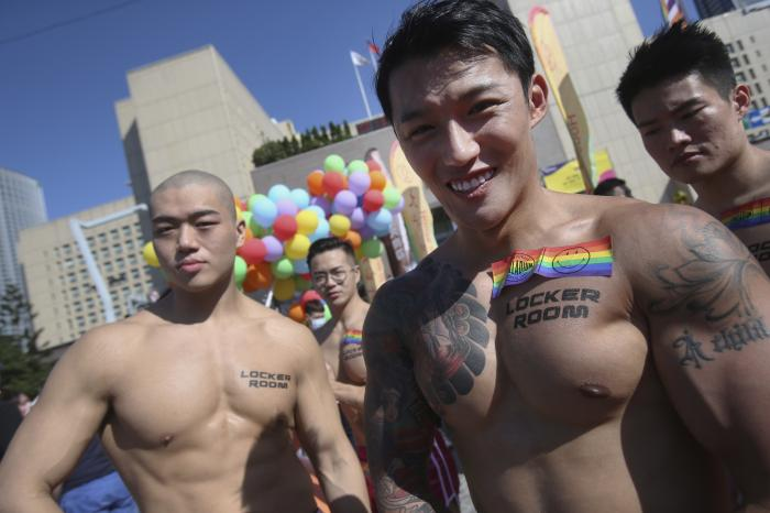 Participants march through a street during a pride parade in Taipei, Taiwan.