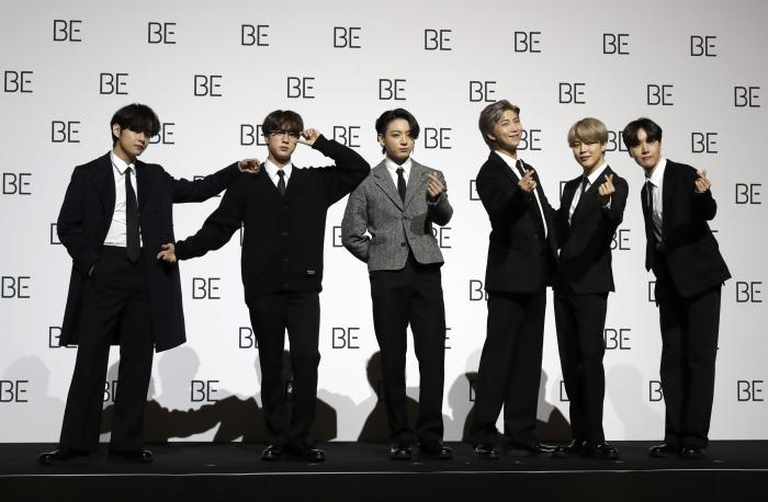 """Members of South Korean K-pop band BTS pose for photographers during a press conference to introduce their new album """"BE"""" in Seoul, South Korea."""