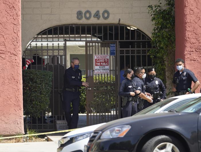 Los Angeles Police Chief Michel Moore exits an apartment complex as police investigate in Reseda, Calif., Saturday, April 10, 2021.