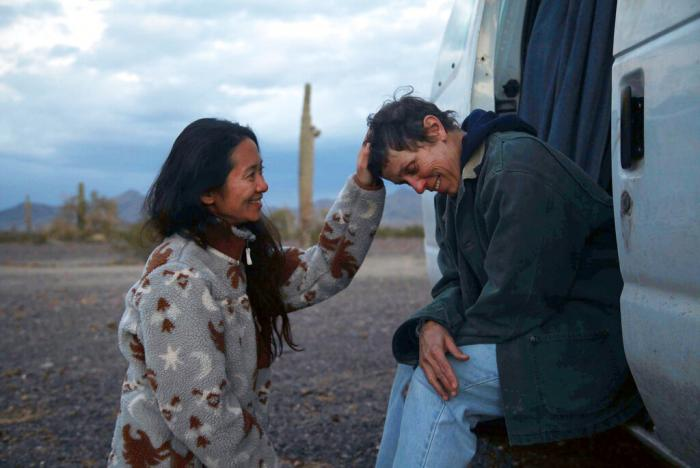 """Director Chloe Zhao, left, appears with actress Frances McDormand on the set of """"Nomadland."""""""
