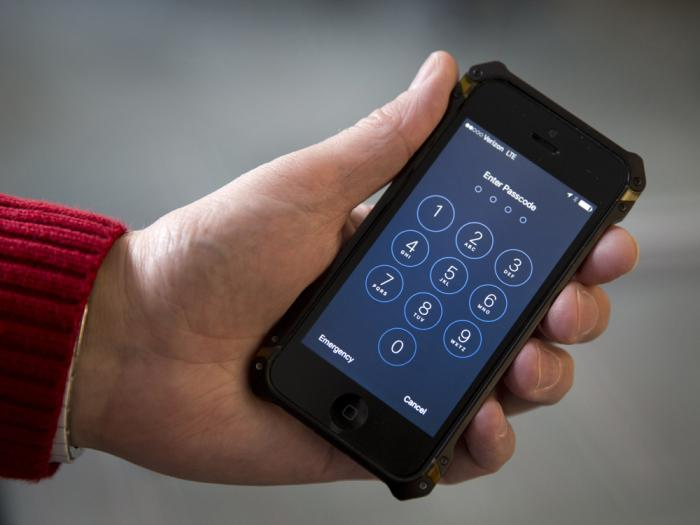 In this Feb. 17, 2016, file photo an iPhone is seen in Washington