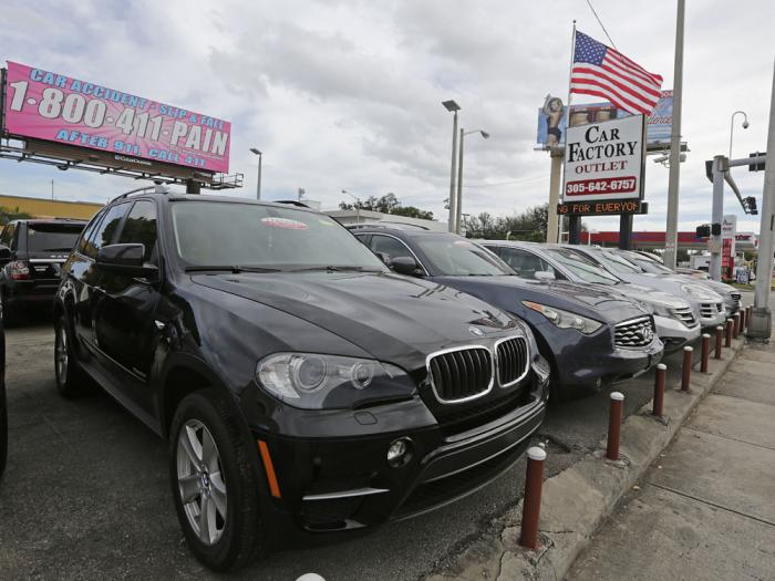 In this Tuesday, Jan. 17, 2017, file photo, certified pre-owned vehicles sit on display at an auto dealership in Miami
